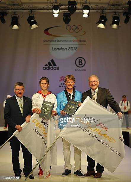 Thomas Bach vice president of the IOC fencer Britta Heidemann rider Frank Ostholt and Michael Vesper director general of the German Olympic sports...