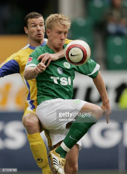 Thomas Baelum of Duisburg and Mike Hanke of Wolfsburg fight for the ball during the Bundesliga match between VfL Wolfsburg v MSV Duisburg at the...