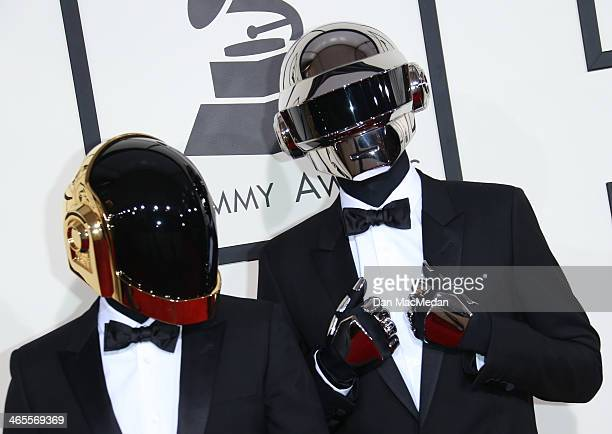 Thomas Bangalter and GuyManuel de HomemChristo of 'Daft Punk' arrive at the 56th Annual GRAMMY Awards at Staples Center on January 26 2014 in Los...