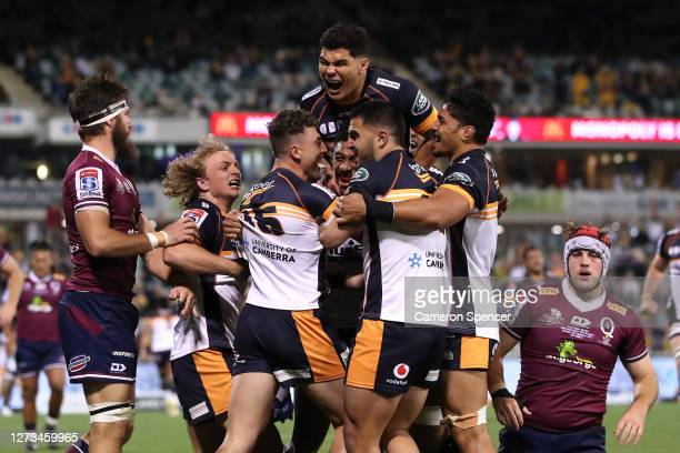 Thomas Banks of the Brumbies celebrates with team mates after scoring a try during the Super Rugby AU Grand Final between the Brumbies and the Reds...