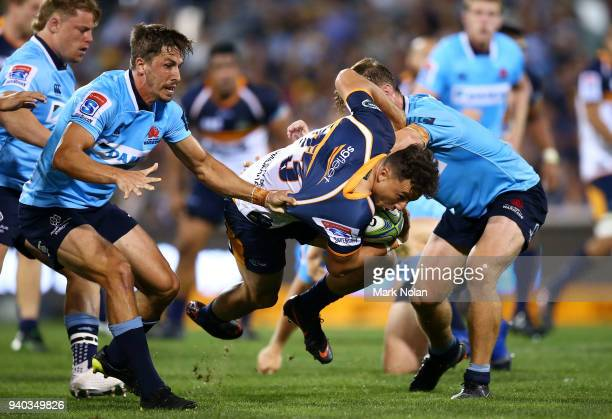 Thomas Banks of the Brumbies is tackled during the round seven Super Rugby match between the Brumbies and the Waratahs at GIO Stadium on March 31,...