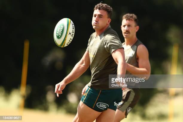 Thomas Banks passes during the Australian Wallabies Captain's Run at RACV Royal Pines Resort on September 17, 2021 in Gold Coast, Australia.
