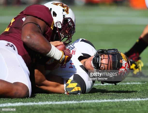 Thomas Barber of the Minnesota Golden Gophers stops Ryan Brand of the Maryland Terrapins on the one yard line in the first quarter at TCF Bank...