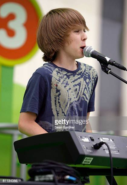 Thomas Batuello of the Naked Brothers Band performs at Fannie C Williams Elementary School during a playground rebuild sponsored by Nickelodeon on...