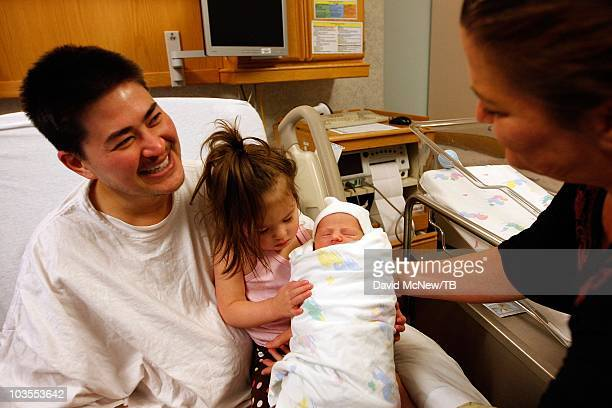 Thomas Beatie a transgender male enjoys his new son Jensen James Beatie on the day after giving birth to him with his wife Nancy by his side at Saint...