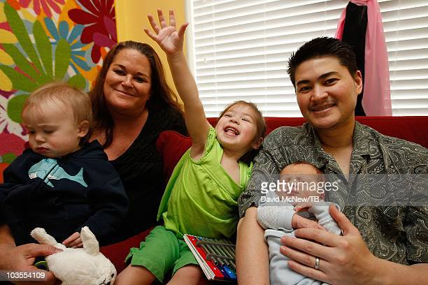 Thomas Beatie a transgender male holds his new son Jensen James Beatie with his wife Nancy after returning home from Saint Charles Medical Center...