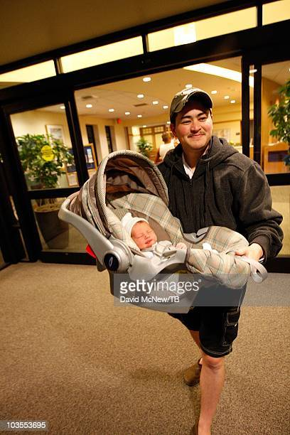 Thomas Beatie a transgender male leaves Saint Charles Medical Center with his new son Jensen James Beatie the day after giving birth to him on July...