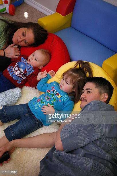 Thomas Beatie and wife Nancy Beatie watch television with daughter Susan Juliette Beatie and son Austin Alexander Beatie on February 17 2010 in Bend...