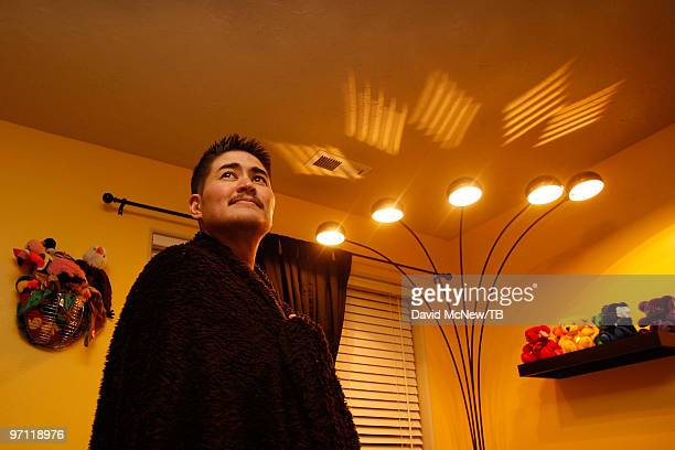 Thomas Beatie covers his shoulders with a blanket on a chilly winter evening on February 17 2010 in Bend Oregon Thomas a transgender male is 17 weeks...