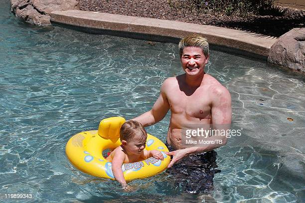 Thomas Beatie enjoys his pool with one year old son Jensen Beatie during the Thomas and Nancy Beatie And Family Photo Shoot on July 26 2011 in...