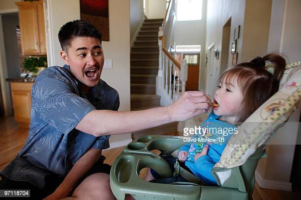Thomas Beatie feeds his daughter Susan Juliette Beatie on February 17 2010 in Bend Oregon Thomas a transgender male is 17 weeks pregnant with his...