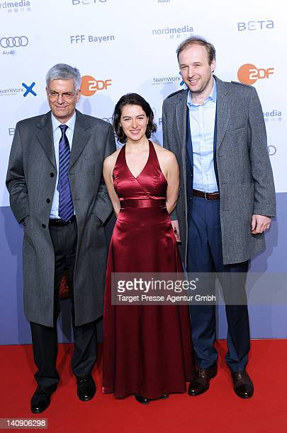 Thomas Bellut, Esther Zimmering and Stephan Grossmann attend the premiere of 'Muenchen 72- Das Attentat' at Astor Film Lounge on March 7, 2012 in...