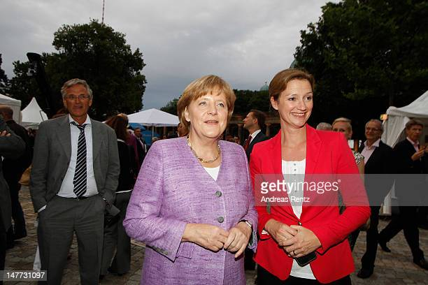 Thomas Bellut German Chancellor Angela Merkel and Bettina Schausten attend the ZDF summer reception on July 2 2012 in Berlin Germany