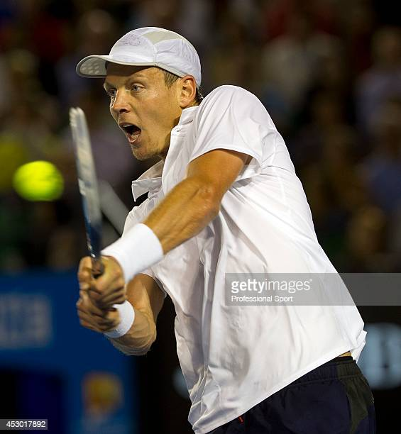 Thomas Berdych of The Czech Republic plays a two-handed backhand during his quarter-final match against Novak Djockovic on day nine of the 2013...