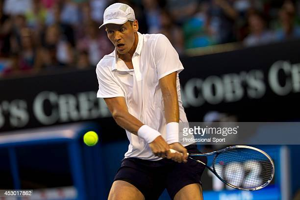 Thomas Berdych of The Czech Republic plays a two-handed forehand during his quarter-final match against Novak Djockovic on day nine of the 2013...