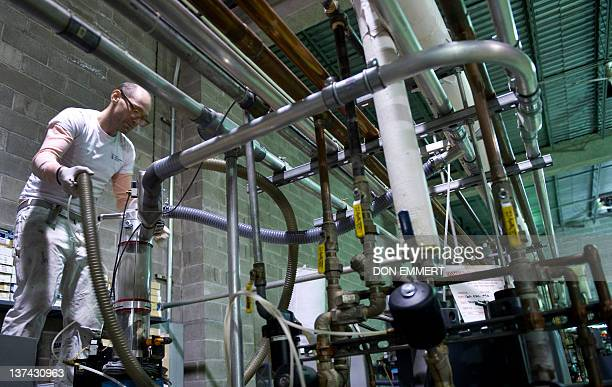 Thomas Bernich checks one of his vinyl pressing machines January 17 2012 in New York The 40yearold Bernich churns out tens of thousands of the...