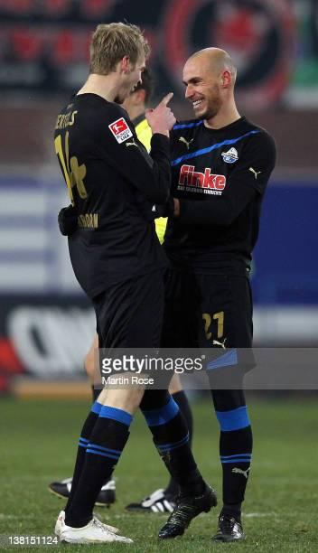Thomas Bertels of Paderborn celebrate with team mate Daniel Brueckner after the Second Bundesliga match between SC Paderborn and Union Berlin at the...