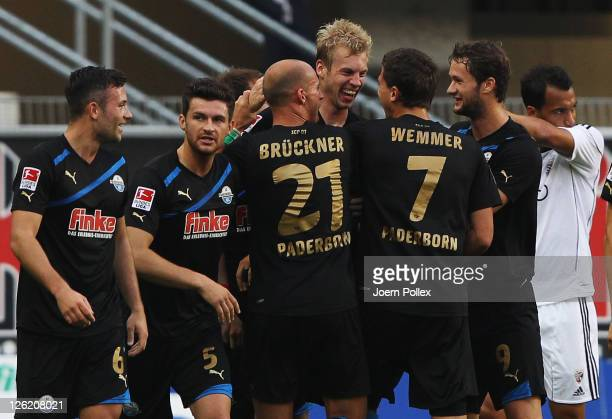 Thomas Bertels of Paderborn celebrates with his team mates after scoring his team's first goal during the Second Bundesliga match between SC...