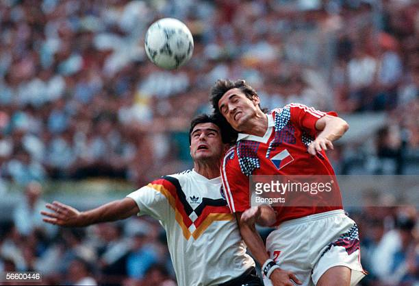 Thomas Berthold of Germany and Ivo Knoflicek of Czechoslovakia battle for the ball during the World Cup quarter final match between Germany and...
