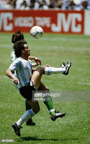 Thomas Berthold of West Germany challenges Jose Cuciuffo of Argentina during the FIFA World Cup final on 29 June 1986 at the Azteca Stadium in Mexico...