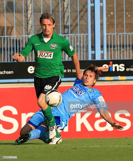 Thomas Birk of Chemnitz fights for the ball with Benjamin Siegert of Muenster during the Third League match between Chemnitzer FC and Preussen...