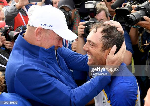 Thomas Bjorn and Francesco Molinari of Europe celebrate after winning The Ryder Cup during singles matches of the 2018 Ryder Cup at Le Golf National...
