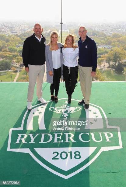 Thomas Bjorn Captain of Europe and girlfriend Grace Barber and Jim Furyk Captain of The United States and wife Tabitha pose on a platform on the...