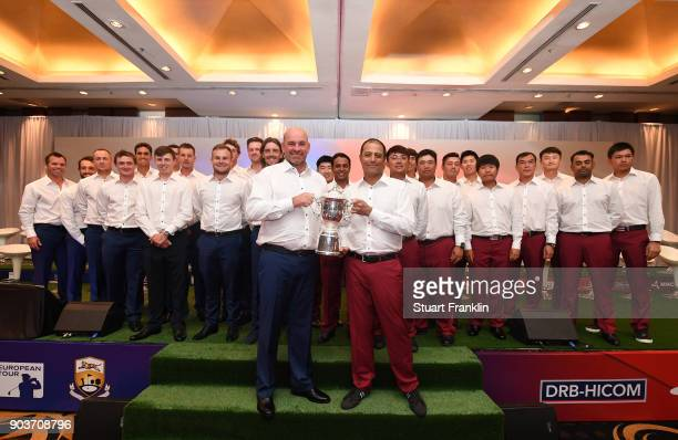 Thomas Bjorn Captain of Team Europe holds the trophy with Arjun Atwal Captain of Team Asia whilst they are accompanied by their players during the...