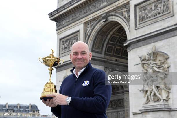 Thomas Bjorn European Captain for the 2018 Ryder Cup in France poses with the Ryder Cup Trophy in front of the Arc De Triomphe on February 22 2017 in...