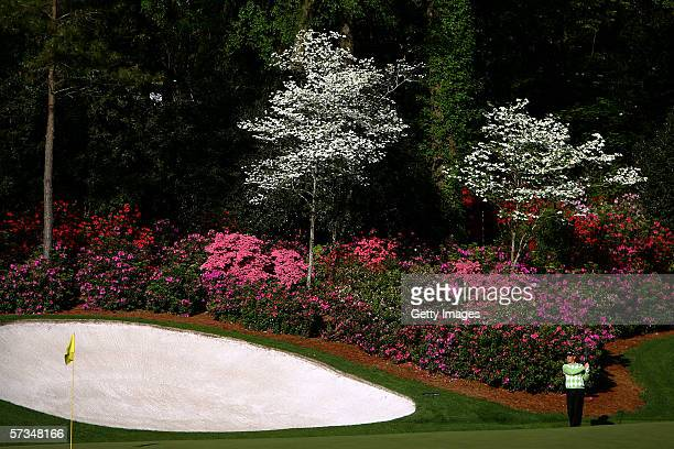 Thomas Bjorn hits out of the rough on the 11th hole during practice for The Masters at the Augusta National Golf Club on April 5 2006 in Augusta...
