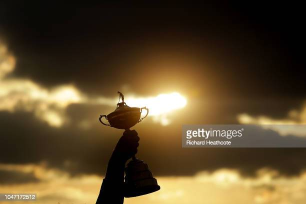 Thomas Bjorn lifts the Ryder Cup Trophy aloft after Europe secure victory after the singles matches of the 2018 Ryder Cup at Le Golf National on...
