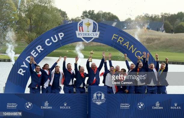 Thomas Bjorn of Denmark and captain of the European Team raises the Ryder Cup after their 175105 win over the United States during the singles...