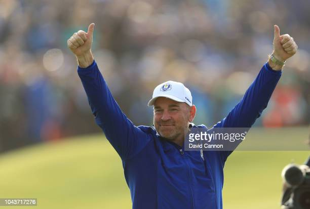 Thomas Bjorn of Denmark and captain of the victorious European Team celebrates on the 18th green after Europe's 175105 win over the United States...