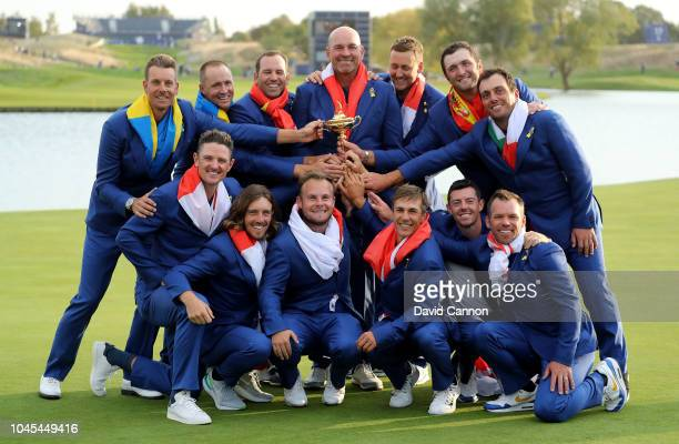 Thomas Bjorn of Denmark and captain of the victorious European Team pose with the Ryder Cup after their 17.5-10.5 win over the United States during...