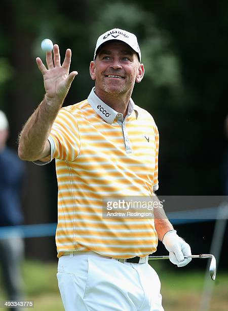 Thomas Bjorn of Denmark gets his ball back after holing his bunker shot on the 15th hole during day two of the BMW PGA Championship at Wentworth on...
