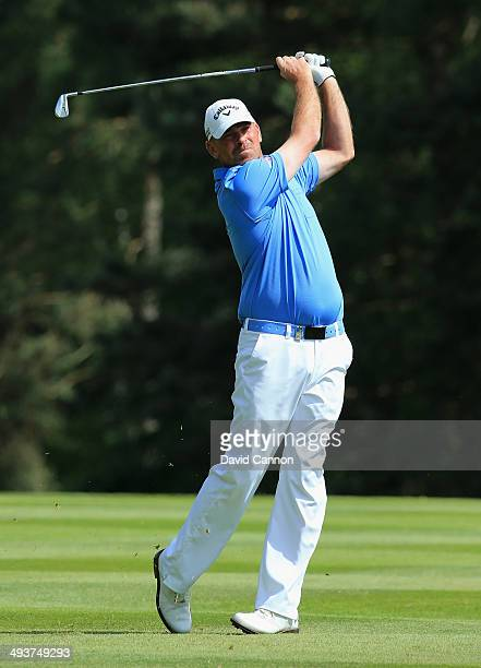 Thomas Bjorn of Denmark hits his 2nd shot on the 9th hole during day four of the BMW PGA Championship at Wentworth on May 25 2014 in Virginia Water...