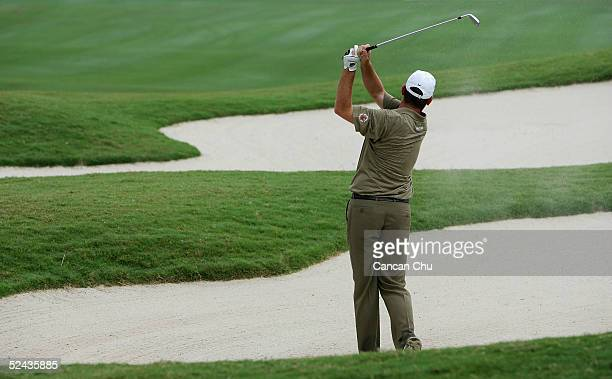Thomas Bjorn of Denmark hits his second shot on the eleventh hole during the TCL Classic at Yalong Bay Golf Club March 17, 2005 in Sanya, Hainan...