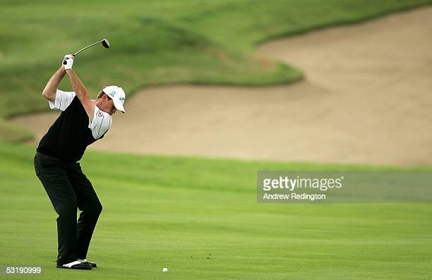 Thomas Bjorn of Denmark hits his second shot on the fourth hole during the final round of the Smurfit European Open on July 3, 2005 on the Palmer...