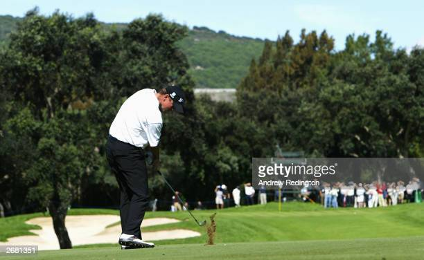 Thomas Bjorn of Denmark hits his second shot on the second hole during the first round of the Volvo Masters Andalucia on October 30, 2003 at...