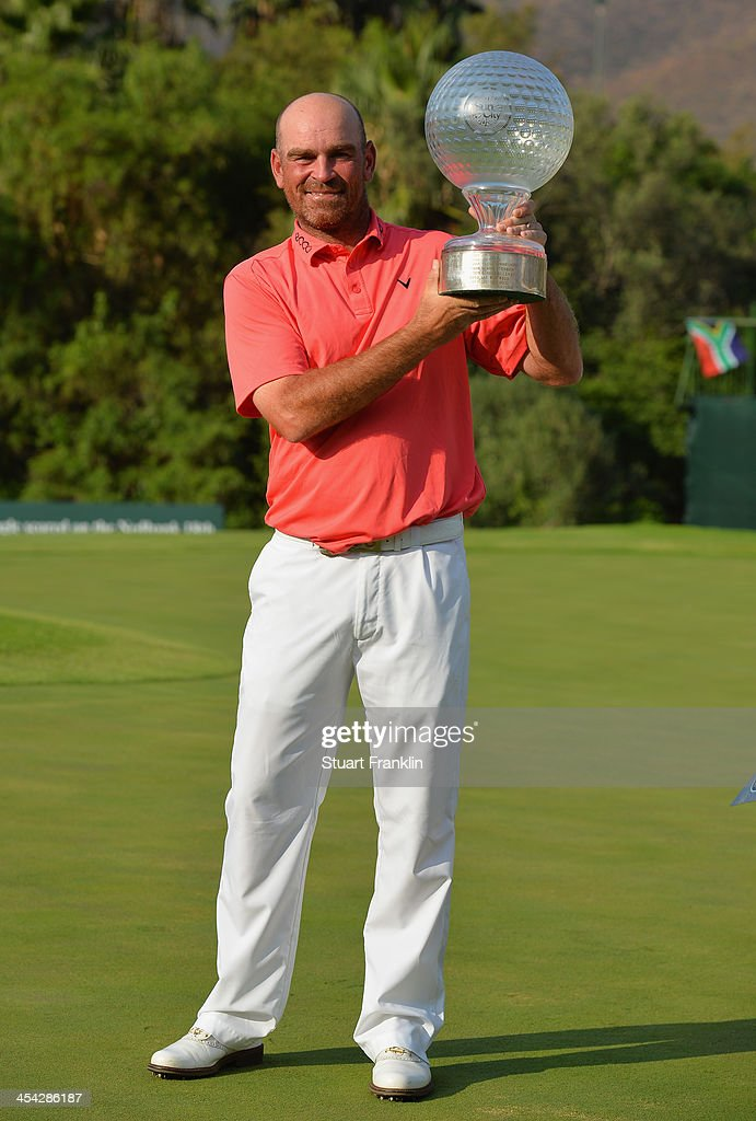 Thomas Bjorn of Denmark holds the trophy after winning the Nedbank Golf Challenge at Gary Player CC on December 8, 2013 in Sun City, South Africa.