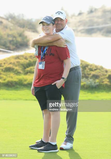 Thomas Bjorn of Denmark is pictured with his son Oliver Bjorn during the Pro Am prior to the start of the NBO Oman Open at Al Mouj Golf on February...