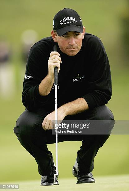 Thomas Bjorn of Denmark lines up his birdie putt on the ninth hole during the first round of The Johnnie Walker Championship on The PGA Centenary...