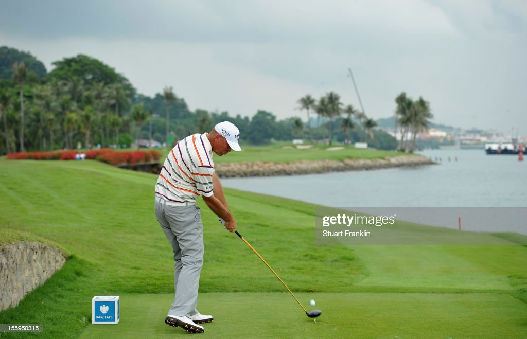 Thomas Bjorn of Denmark plays a shot during the resumption of the rain delayed second round of the Barclays Singapore Open at the Sentosa Golf Club on November 10, 2012 in Singapore.