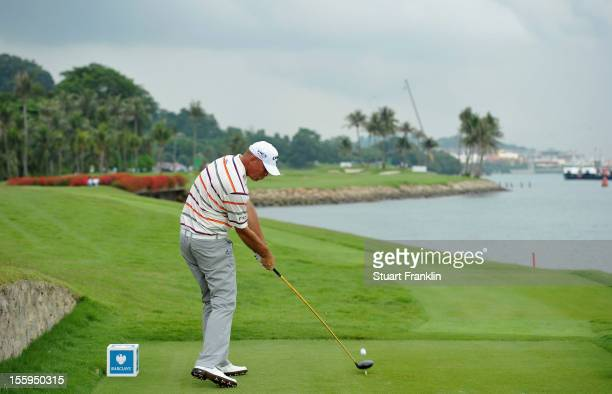 Thomas Bjorn of Denmark plays a shot during the resumption of the rain delayed second round of the Barclays Singapore Open at the Sentosa Golf Club...