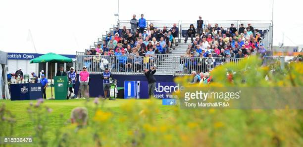 Thomas Bjorn of Denmark plays his first shot on the 1st tee during the Open Series Qualifying AAM Scottish Open at Dundonald Links Golf Course on...