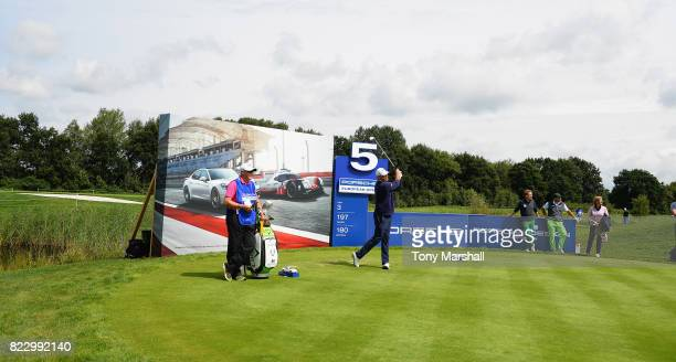 Thomas Bjorn of Denmark plays his first shot on the 5th tee during the Porsche European Open Pro Am at Green Eagle Golf Course on July 26 2017 in...