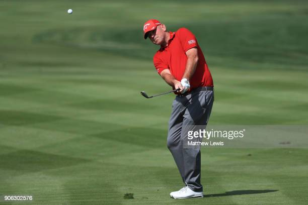 Thomas Bjorn of Denmark plays his third shot on the second hole during round one of the Abu Dhabi HSBC Golf Championship at Abu Dhabi Golf Club on...