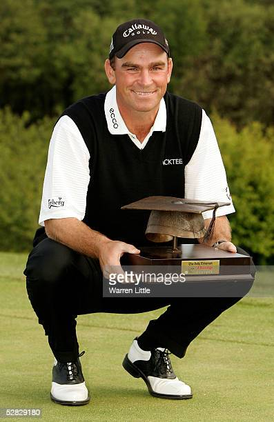 Thomas Bjorn of Denmark poses with the trophy after winning The Daily Telegraph Dunlop British Masters after a Threeway playoff on the second extra...