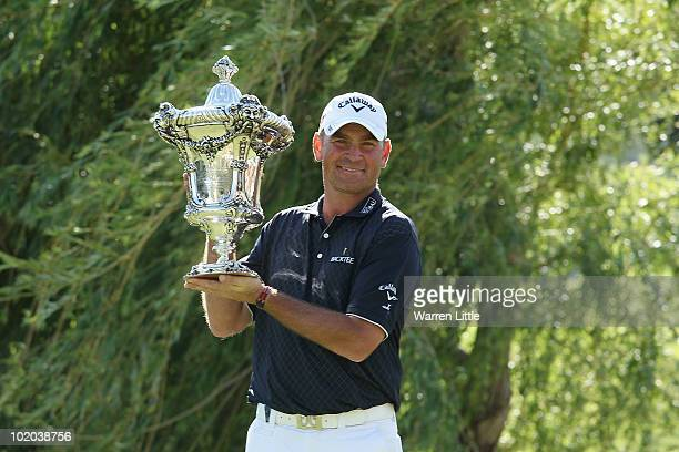 Thomas Bjorn of Denmark poses with the trophy after winning the Estoril Open de Portugal at Penha Longa Hotel Spa and Golf Club on June 13 2010 in...
