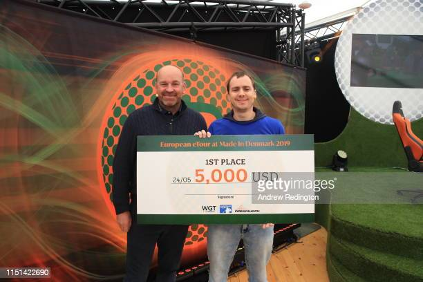 Thomas Bjorn of Denmark present Christopher Aitken with the winner cheque after winning the European eTour Championship which took place during the...